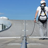 VERTIC's COMBIRAIL inclined fall protection rail system with switch